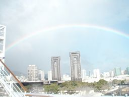 April caught this rainbow framing the Honolulu skyline before our cruise sailed.