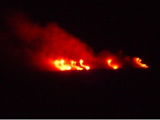 Lava flows into the ocean at night off Hilo, HI