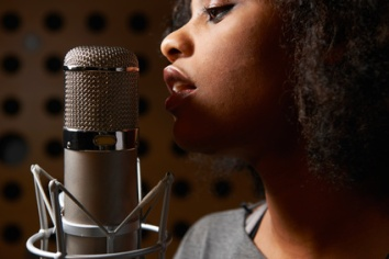 Female Vocalist In Recording Studio