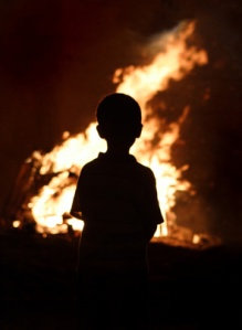 Child watching the fire