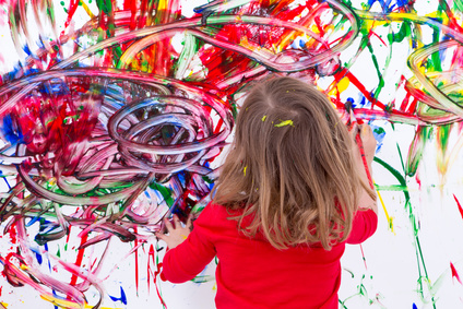 Young Kid Painting Abstract on White Wall