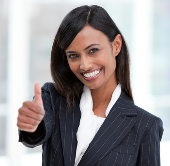 Cheerful businesswoman with a thumb up standing